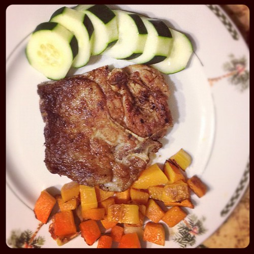 Whole30 day 4. Dinner. Mediterranean porkchops with roasted garlic butternut squash and cucumber. See @kainoe808 I ate a cucumber!