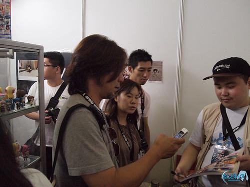 Taking photo of the signed photobook