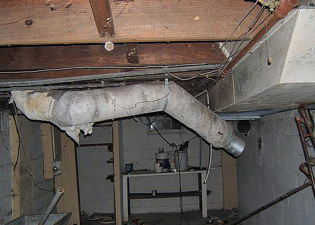 Hvac Duct Insulation : Home heating duct with damaged asbestos paper insulation