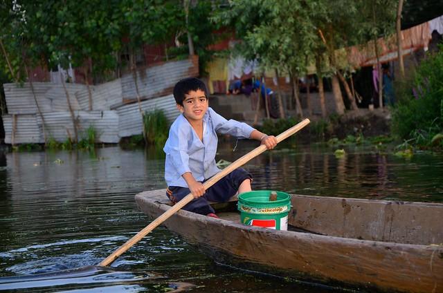 Child on Lake Dal, India.