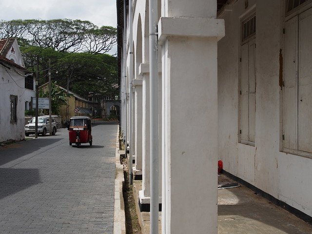 A tuktuk and pillars