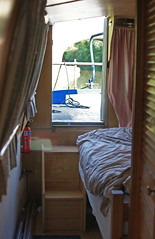 vehicle(0.0), window covering(0.0), art(1.0), window(1.0), furniture(1.0), wood(1.0), room(1.0), cabin(1.0), bed(1.0), interior design(1.0),