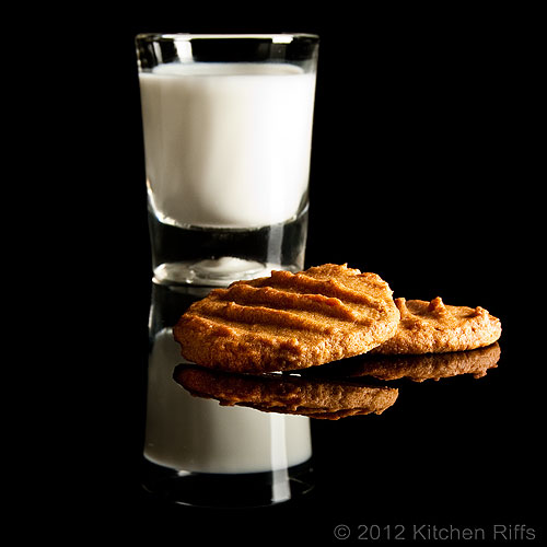 Peanut Butter Cookies and Glass of Milk on Black Acrylic