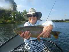 Judy enjoys a big sunny day Rainbow on the Lower Sac