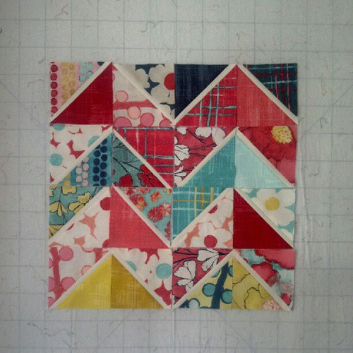 Auditioning some block layouts using double flip HSTs and gorgeous @lauragunnstudio charms!