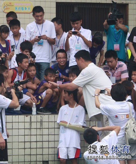 August 24th, 2012 - Yao Ming shakes hands at a basketball camp in Sichuan