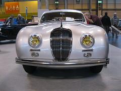 automobile, jaguar xk120, vehicle, automotive design, auto show, antique car, classic car, vintage car, land vehicle, luxury vehicle, convertible,