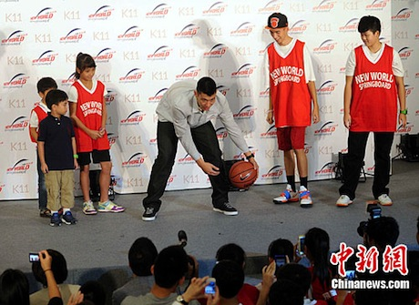 August 24th, 2012 - Jeremy Lin at the K11 shopping center in Hong Kong for a New World event