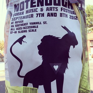 An instagram photo of a Not Enough! poster hanging on a Portland street post. It has their iconic lion-goat-snake hybrid roaring as well as the details of the night.