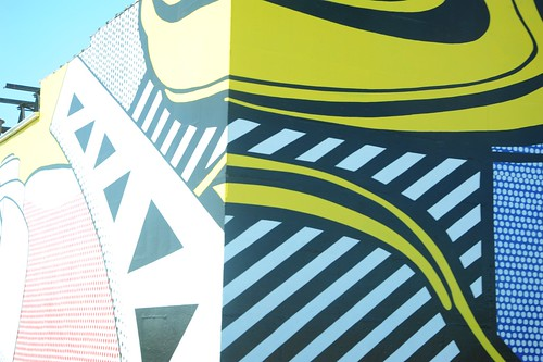 Roy Lichtenstein, industrial painting, pop art, bridge, comic book style, ad on building, freeway, Chicago, Illinois, USA by Wonderlane