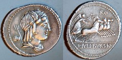 RRC 352/1c L.IVLI BVRSIO Julia Denarius. Neptune, Victory quadriga. Rome 85BC. Obverse control mark two Janus head bronze asses. Remarkable.