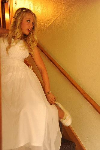Jessie's getting married, in her wedding dress, pausing, putting on her shoe, staircase, the Mason's house, Tail Waggin' Lane, Fairbanks, Alaska, USA by Wonderlane