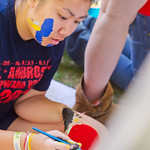 12-025 -- Helen Hoang '16 wears the paint as she designs a mural.