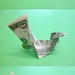 Dollar bill bird that lays egg by FJ Contreras