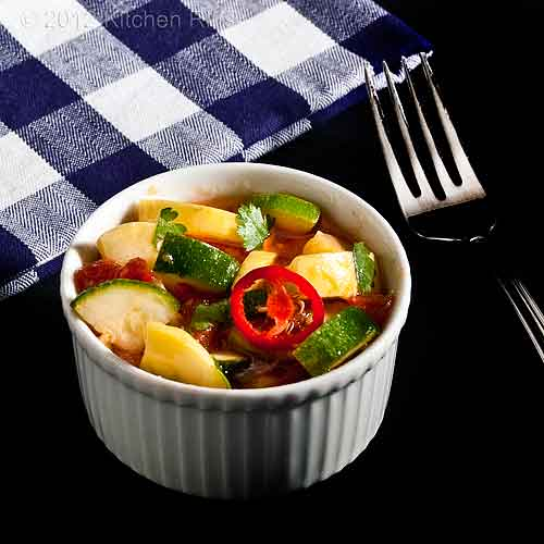 Summer Squash in Tomato Curry Sauce in White Ramekin with Fork and Napkin
