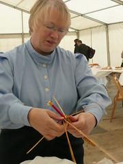 Helen Moran weaving a corn dolly