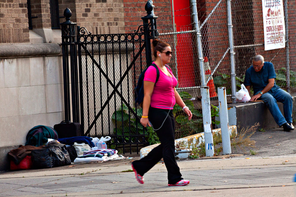 Man-with-much-belongings-outside-church--South-Broad