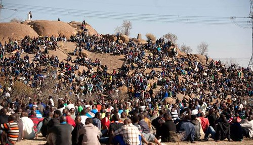 South African workers at the Lonmin strike area where platinum is extracted. Violence in the mines has resulted in over 40 deaths in August 2012. by Pan-African News Wire File Photos
