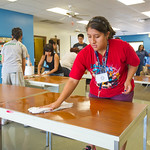 12-004 -- MALANA students got the chance to serve the community by helping set up and clean for the coming school year at the Unity Community Center. Christina Cervantes '16 washed tables, chairs and walls.
