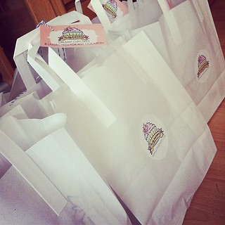 Long line of bags of cupcakes going to the Game of Thrones set, best order ever!