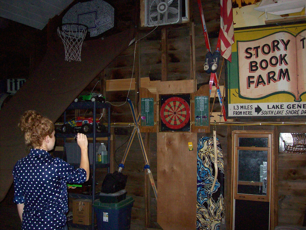 playing darts in my parents' barn