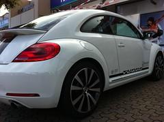 sedan(0.0), automobile(1.0), volkswagen beetle(1.0), automotive exterior(1.0), wheel(1.0), volkswagen(1.0), vehicle(1.0), automotive design(1.0), volkswagen new beetle(1.0), rim(1.0), subcompact car(1.0), city car(1.0), bumper(1.0), land vehicle(1.0), luxury vehicle(1.0),