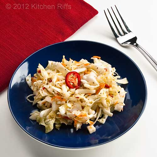Garlic Coleslaw with Red Jalapeño Pepper Garnish on Blue Plate