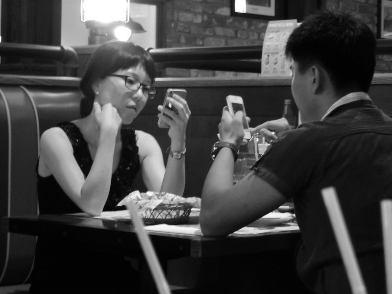 Couple on a Date with their Cellphones