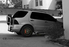 automobile(1.0), tire(1.0), automotive tire(1.0), automotive exterior(1.0), sport utility vehicle(1.0), mini sport utility vehicle(1.0), wheel(1.0), vehicle(1.0), rim(1.0), mercedes-benz m-class(1.0), bumper(1.0),