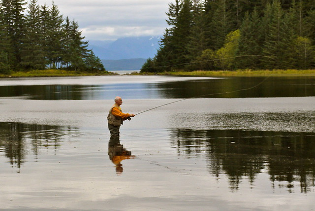 man fly-fishing in a lake
