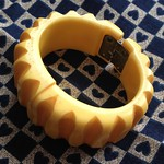 yellow carved bakelite bangle