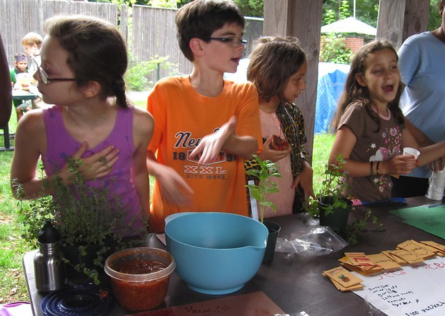 Children's Garden participants promote their chutney, seed packets and other handmade items at Market Day. Photo by Sarah Schmidt.