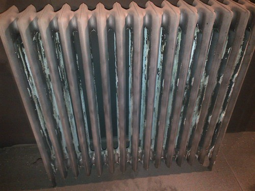 Cast iron radiators in need of cleaning and restoration