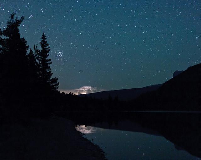 The Pleiades over lightning