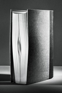 black and white photo of a book spine that looks kinda like a vagina
