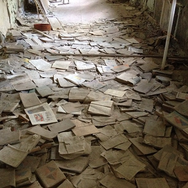 Books strewn about an abandoned school hallway #chernobyl