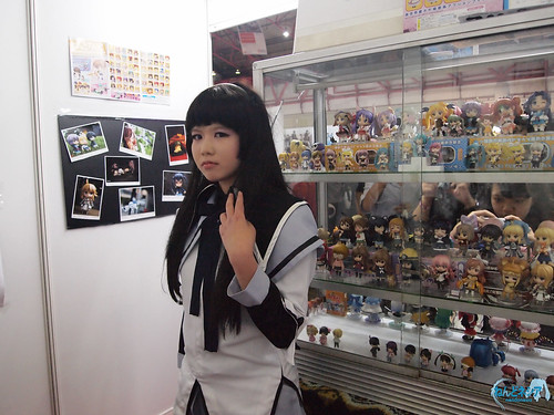 A cosplayer posing inside the booth