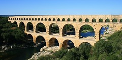 amphitheatre(0.0), monastery(0.0), tourism(0.0), fortification(0.0), devil's bridge(1.0), ancient roman architecture(1.0), arch(1.0), aqueduct(1.0), river(1.0), landmark(1.0), architecture(1.0), ancient rome(1.0), arch bridge(1.0), viaduct(1.0), waterway(1.0), bridge(1.0),