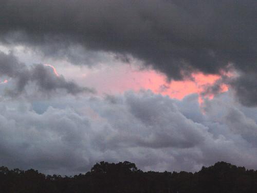 pink light sunset summer reflection clouds mi dark ominous threatening lakemichigan westlake waterspouts september2012