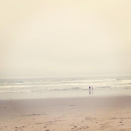 Little girls in big ocean.