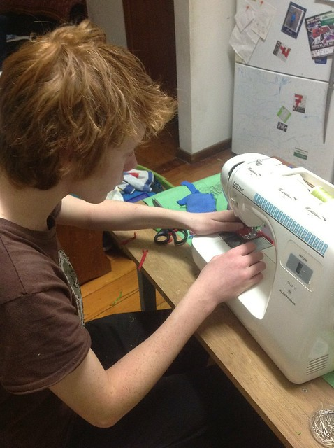 Declan sewing his first iPod sock