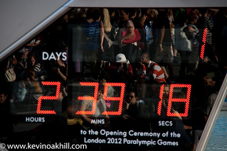 Reflection of crowds in the Paralympic countdown clock, Trafalgar Square, London