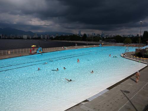 Luminous pool with dark Vancouver skyline