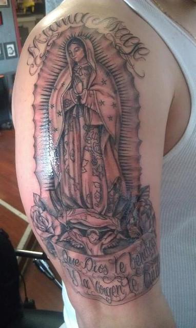 black and grey virgin Mary tattoo