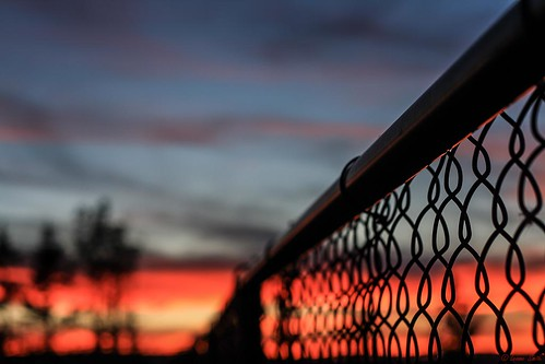 Chain links and a sky on fire