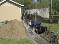 Randy and Jimmy build the garden bed