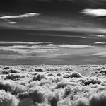 24. September 2015 - 17:01 - A window seat image taken not long after flying out of Austin and clearing some clouds to the west. I wanted to not just capture that look across the clouds but also of the deeper blue skies as we got higher in altitude. I found converting to Black & White with Capture NX2 brought out a much deeper shade to the skies above.