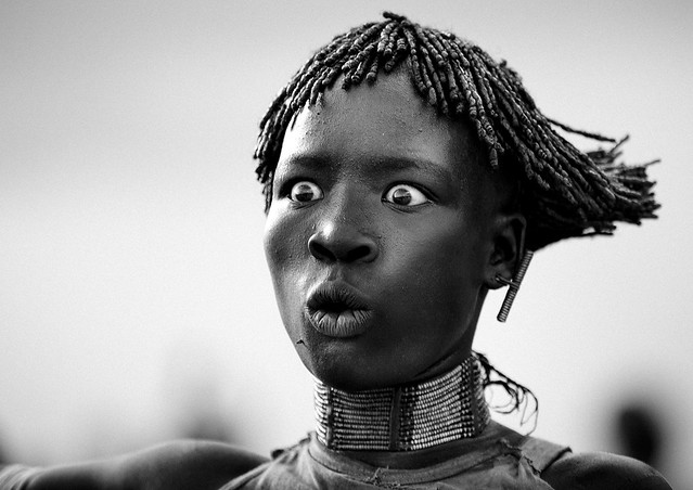 Hamer woman asking to be whipped, Omo Ethiopia