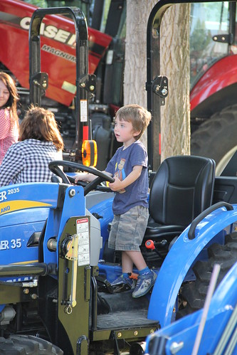 Olsen driving a tractor