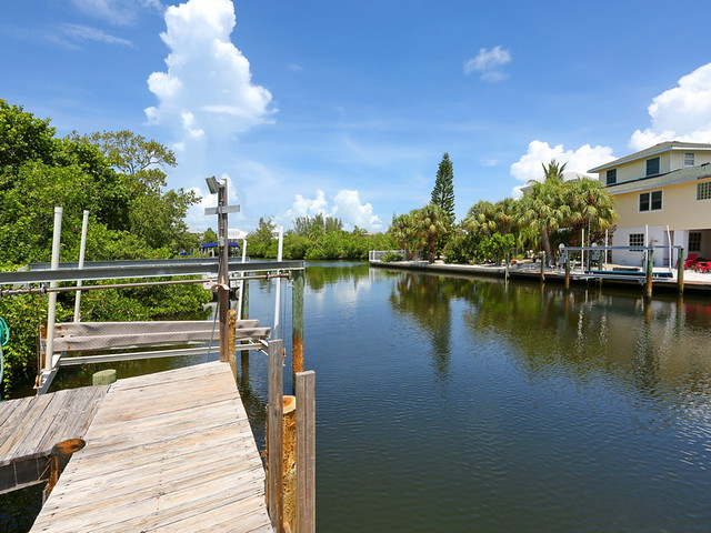 Deep water canal dock boat lift flickr photo sharing for Deep sea fishing anna maria island